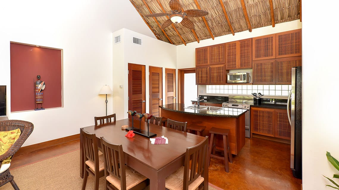 Kitchen and dining table in Luxury Villa at Victoria House Resort and Spa