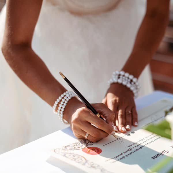 Signing wedding documents at Victoria House Resort and Spa