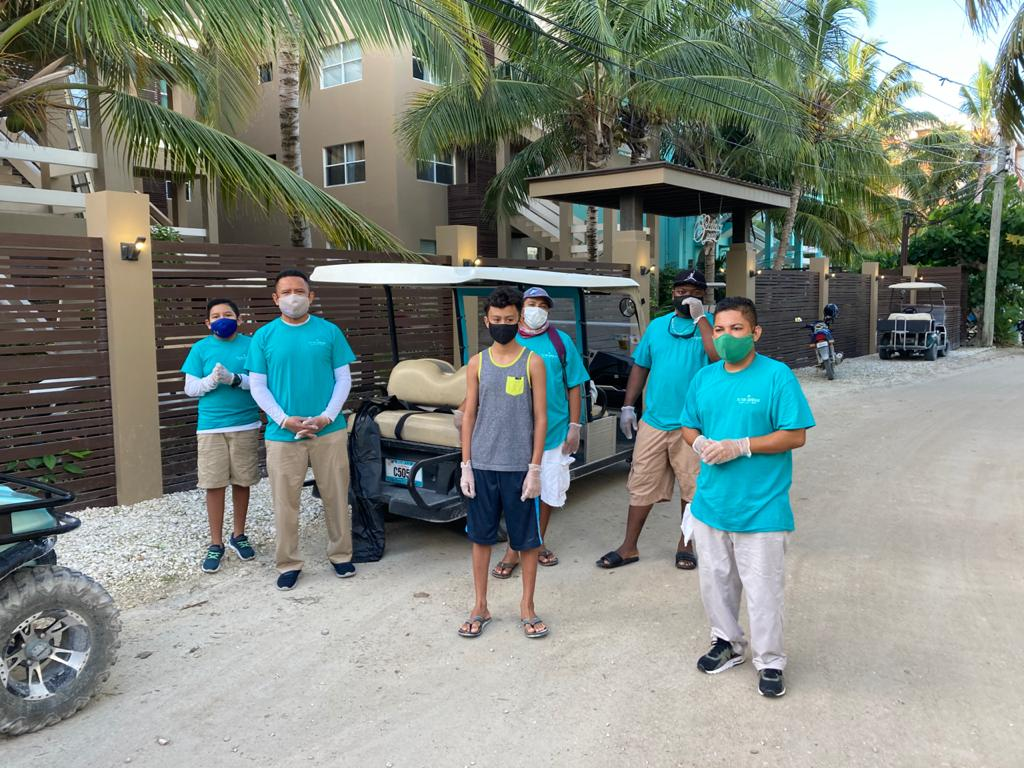 Victoria House Belize staff during beach clean up at Reef Week